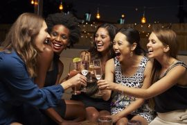 Group of Women Laughing and Toasting With Wine: Bachelorette Party Ideas in PA