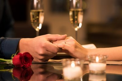 Couple Holding Hands at Valentine's Day Dinner
